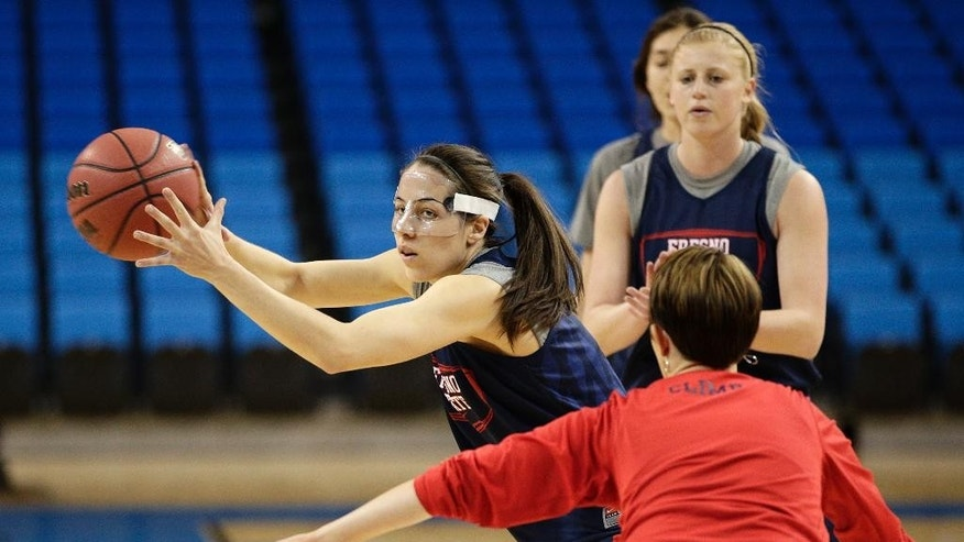 Fresno State's Bree Farley, center, grabs the ball during practice for the NCAA women's college basketball tournament on Friday, March 21, 2014, in Los Angeles. Fresno State is scheduled to play Nebraska in a first-round game on Saturday. (AP Photo/Jae C. Hong)