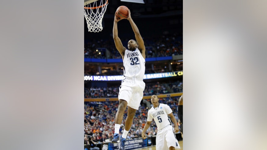 Villanova's James Bell (32) dunks the ball as teammate Tony Chennault (5) trails the play during first half of a second-round game against Milwaukee in the NCAA college basketball tournament in Buffalo, N.Y., Thursday, March 20, 2014. (AP Photo/Nick LoVerde)