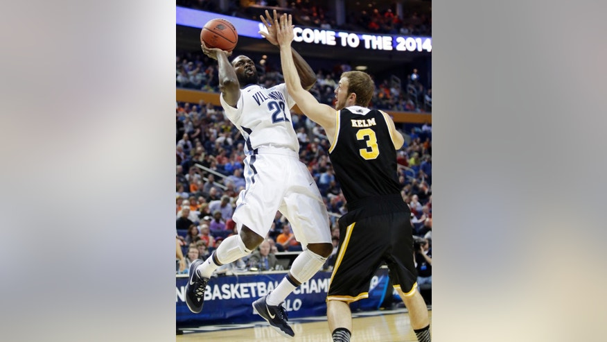 Villanova's JayVaughn Pinkston (22) shoots over Milwaukee's Kyle Kelm (3) during the first half of a second-round game in the NCAA college basketball tournament in Buffalo, N.Y., Thursday, March 20, 2014. (AP Photo/Nick LoVerde)