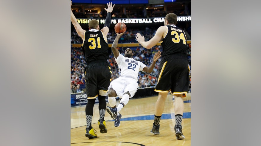 Villanova's JayVaughn Pinkston (22) shoots over Milwaukee's Matt Tiby (31) and Austin Arians (34) during the first half of a second-round game in the NCAA college basketball tournament in Buffalo, N.Y., Thursday, March 20, 2014. (AP Photo/Nick LoVerde)