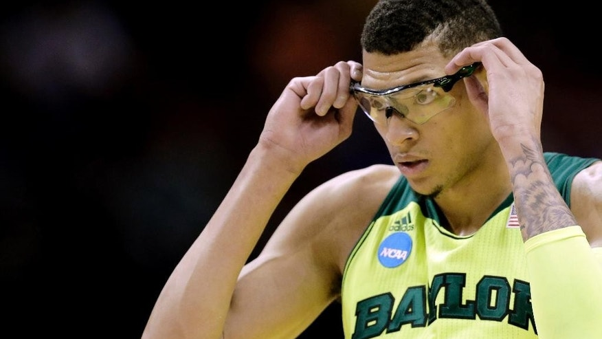 Baylor's Isaiah Austin adjusts his glasses during the first half of a second-round game against Nebraska in the NCAA college basketball tournament Friday, March 21, 2014, in San Antonio. (AP Photo/Eric Gay)