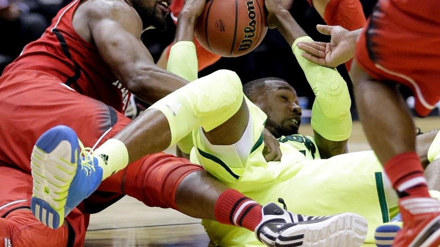 Baylor's Cory Jefferson, right, and Nebraska's Leslee Smith, left, battle for a loose ball during the first half of a second-round game in the NCAA college basketball tournament Friday, March 21, 2014, in San Antonio. (AP Photo/Eric Gay)