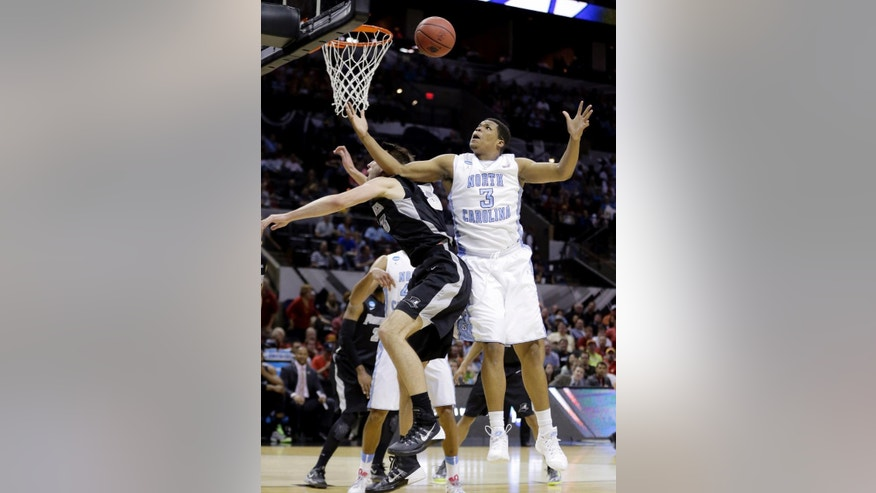 North Carolina's Kennedy Meeks (3) reaches for a rebound over Providence's Carson Desrosiers (33) during the first half of a second-round game in the NCAA college basketball tournament Friday, March 21, 2014, in San Antonio. (AP Photo/Eric Gay)