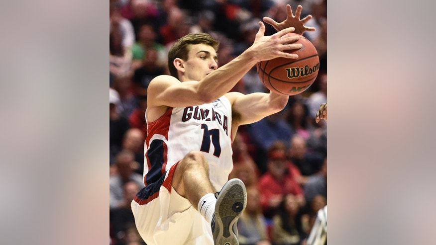 Gonzaga guard David Stockton pulls in a loose ball during the second half in a second-round game against Oklahoma State in the NCAA men's college basketball tournament Friday, March 21, 2014, in San Diego. (AP Photo/Denis Poroy)