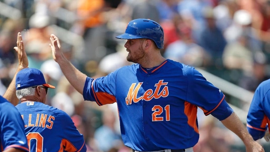 New York Mets' Lucas Duda is congratulated after scoring on a two-run double by Ike Davis in the first inning of a exhibition baseball game against the Minnesota Twins in Fort Myers, Fla., Friday, March 21, 2014. (AP Photo/Gerald Herbert)