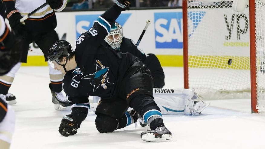San Jose Sharks goalie Antti Niemi, right, is beaten for a goal on a shot by Anaheim Ducks' Mathieu Perreault, not pictured, during the second period of an NHL hockey game Thursday, March 20, 2014, in San Jose, Calif. (AP Photo/Marcio Jose Sanchez)