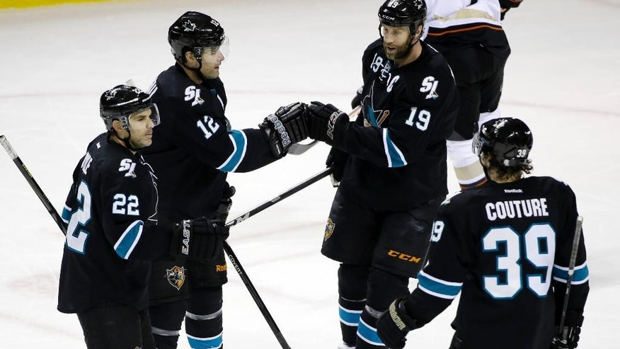 San Jose Sharks' Patrick Marleau (12) celebrates his goal with teammates Dan Boyle (22), Joe Thornton (19), and Logan Couture (39) during the first period of an NHL hockey game against the Anaheim Ducks on Thursday, March 20, 2014, in San Jose, Calif. (AP Photo/Marcio Jose Sanchez)