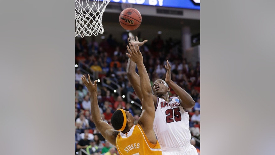 Massachusetts' Cady Lalanne shoots over Tennessee forward Jarnell Stokes (5) during the first half of an NCAA college basketball second-round tournament game, Friday, March 21, 2014, in Raleigh, N.C. (AP Photo/Chuck Burton)