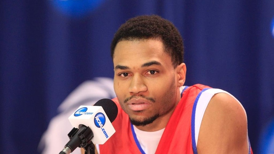 Dayton player Vee Sanford speaks during a news conference at the NCAA college basketball tournament in Buffalo, N.Y., Friday, March 21, 2014. Syracuse plays Dayton in a third-round game on Saturday. (AP Photo/The Buffalo News, Harry Scull Jr.) TV OUT; MAGS OUT; SALAMANCA PRESS OUT; TONAWANDA NEWS OUT