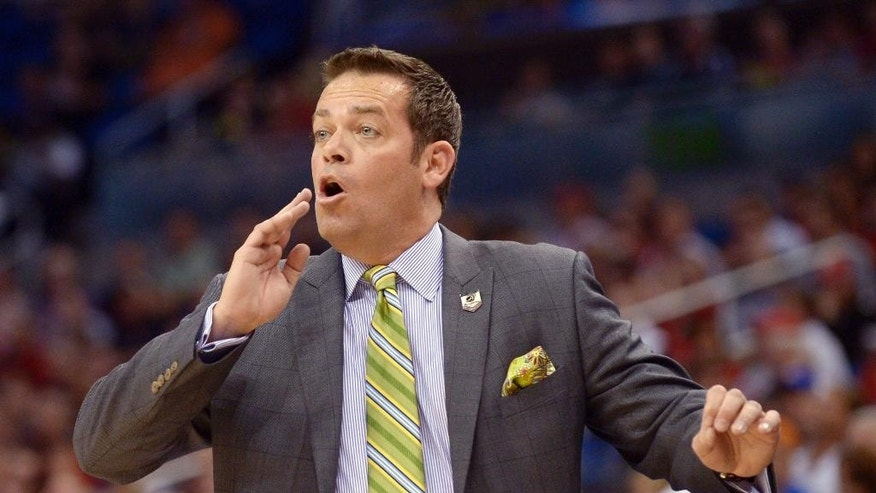 Manhattan coach Steve Masiello yells at his team during the first half against Louisville in a second-round game in the NCAA college basketball tournament Thursday, March 20, 2014, in Orlando, Fla. (AP Photo/Phelan M. Ebenhack)