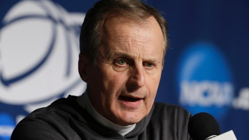 Texas head coach Rich Barnes speaks during a news conference for the third-round game of the NCAA college basketball tournament Friday, March 21, 2014, in Milwaukee. Texas plays Michigan on Saturday. (AP Photo/Morry Gash)