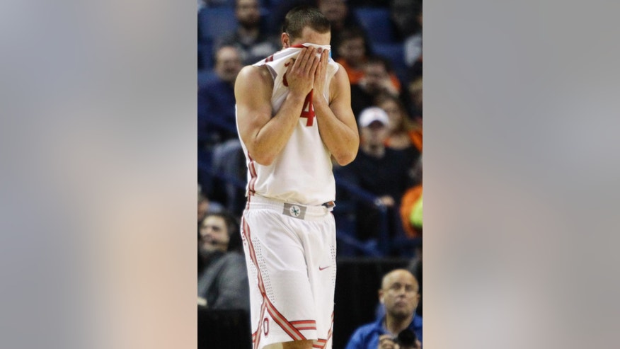 Ohio State's Aaron Craft (4) reacts after a call during the second half of a second-round game against Dayton in the NCAA college basketball tournament in Buffalo, N.Y., Thursday, March 20, 2014. Dayton won the game 60-59. (AP Photo/Bill Wippert)