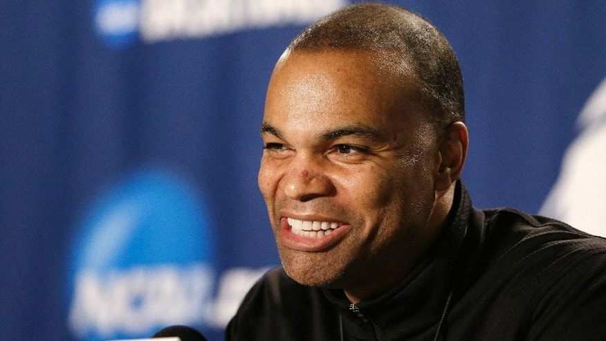 Harvard coach Tommy Amaker smiles while speaking at a news conference at the NCAA men's college basketball tournament in Spokane, Wash., Friday, March 21, 2014. Harvard plays Michigan State on Saturday in the third round. (AP Photo/Elaine Thompson)