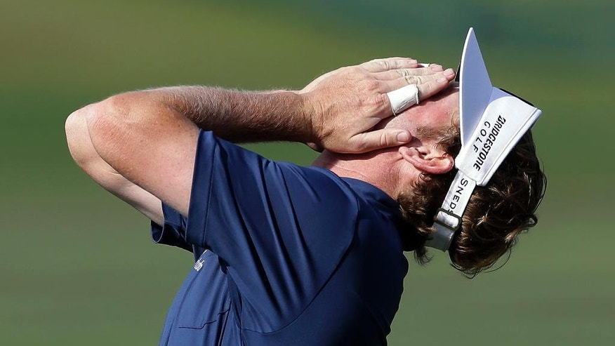 Brandt Snedeker covers his face after missing a birdie putt on the 16th hole during the second round of the Arnold Palmer Invitational golf tournament at Bay Hill on Friday, March 21, 2014, in Orlando, Fla. (AP Photo/Chris O'Meara)