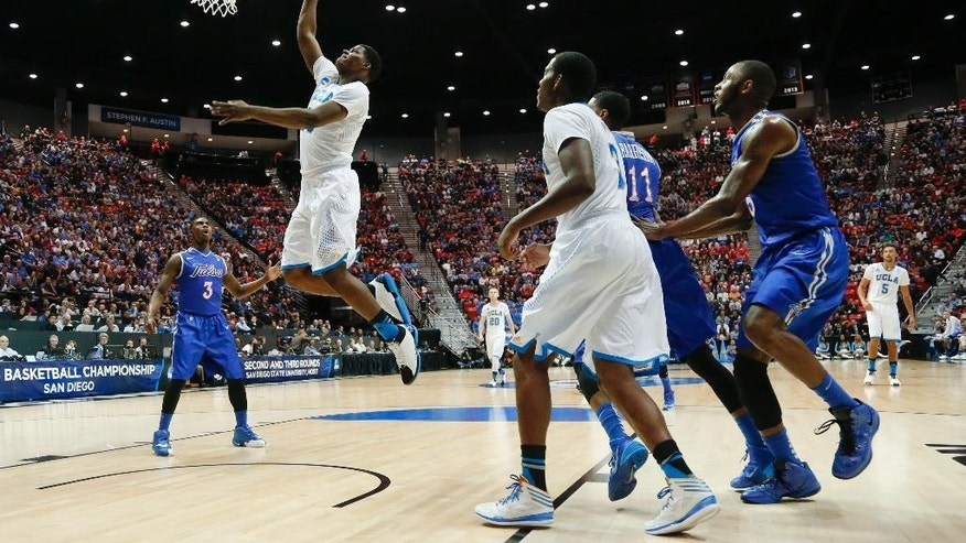 UCLA forward Tony Parker, second from left, shoots against Tulsa during the first half of a second-round game in the NCAA men's college basketball tournament Friday, March 21, 2014, in San Diego. (AP Photo/Lenny Ignelzi)