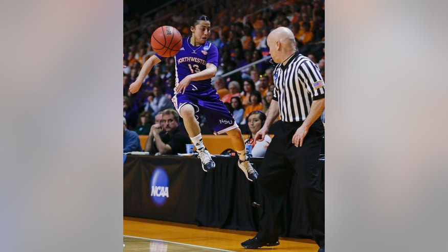 Northwestern State guard Janelle Perez tries to keep the ball in bounds in the first half of an NCAA women's college basketball first-round tournament game against Tennessee, Saturday, March 22, 2014, in Knoxville, Tenn. (AP Photo/Mark Humphrey)