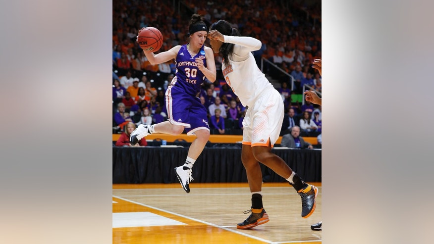 Northwestern State guard Beatrice Attura (30) is defended by Tennessee forward Bashaara Graves, right, in the first half of an NCAA women's college basketball first-round tournament game Saturday, March 22, 2014, in Knoxville, Tenn. (AP Photo/John Bazemore)