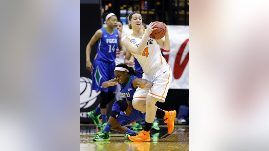 Florida Gulf Coast guard Kaneisha Atwater, left, crashes into Oklahoma State forward Liz Donohoe as they go for the ball during the second half of a first-round game in the NCAA women's college basketball tournament in West Lafayette, Ind., Saturday, March 22, 2014. Oklahoma State defeated Florida Gulf Coast 61-60 in overtime. (AP Photo/Michael Conroy)