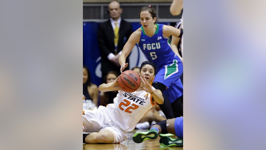 Oklahoma State guard Brittney Martin (22) grabs a loose ball in front of Florida Gulf Coast guard Sarah Hansen during the second half of a first-round game in the NCAA women's college basketball tournament in West Lafayette, Ind., Saturday, March 22, 2014. Oklahoma State defeated Florida Gulf Coast 61-60 in overtime. (AP Photo/Michael Conroy)