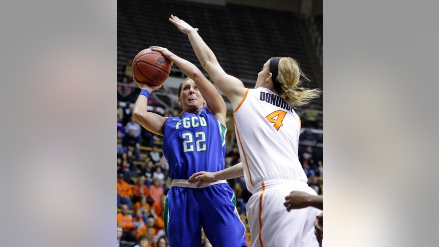 Florida Gulf Coast guard Jenna Cobb (22) looks to shoot over Oklahoma State forward Liz Donohoe during the second half of a first-round game in the NCAA women's college basketball tournament in West Lafayette, Ind., Saturday, March 22, 2014. Oklahoma State defeated Florida Gulf Coast 61-60 in overtime. (AP Photo/Michael Conroy)