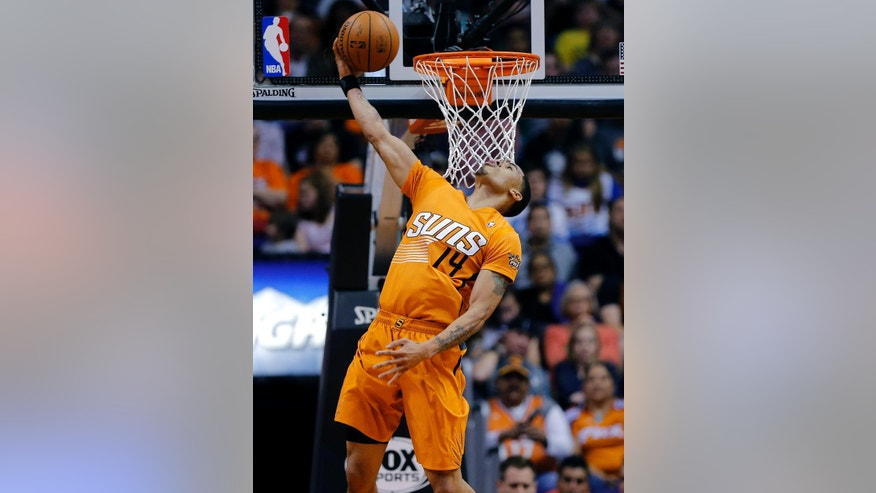 Phoenix Suns' Gerald Green (14) dunks against the Detroit Pistons during the first half of an NBA basketball game, Friday, March 21, 2014, in Phoenix. (AP Photo/Matt York)