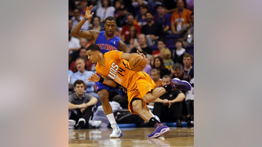 Phoenix Suns' Gerald Green (14) drives past Detroit Pistons' Brandon Jennings during the first half of an NBA basketball game, Friday, March 21, 2014, in Phoenix. (AP Photo/Matt York)