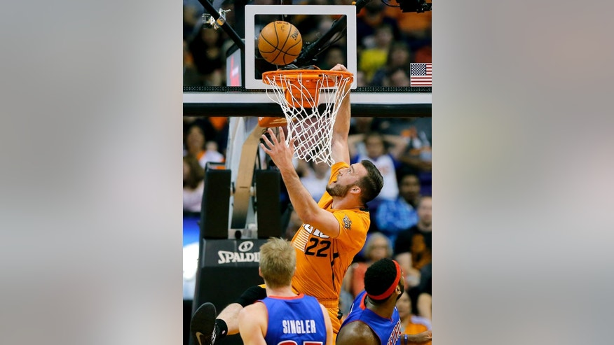 Phoenix Suns' Miles Plumlee (22) misses a dunk against the Detroit Pistons during the first half of an NBA basketball game, Friday, March 21, 2014, in Phoenix. (AP Photo/Matt York)
