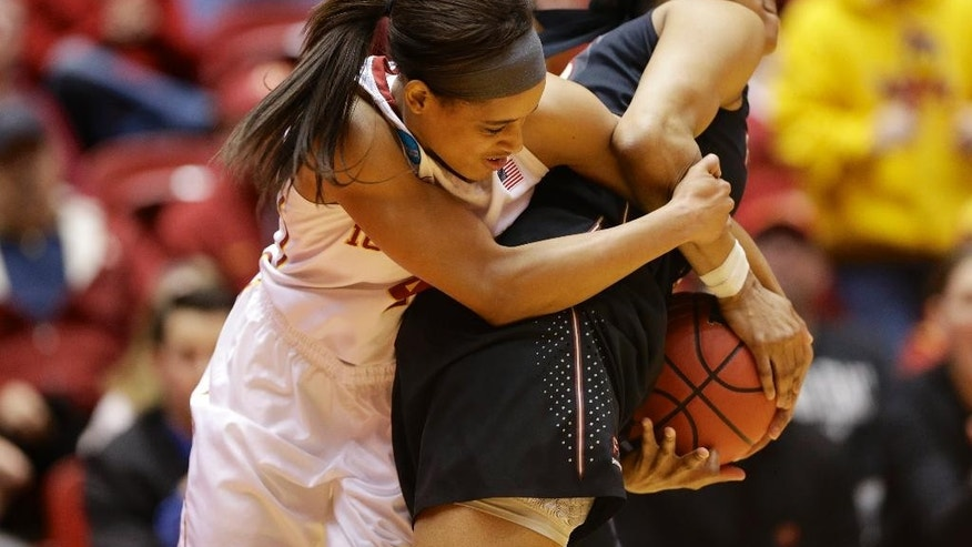 Iowa State's Nikki Moody, left, and Florida State's Ivey Slaughter, right, struggle for the ball in the first half of a first-round game in the NCAA women's college basketball tournament in Ames, Iowa, Saturday, March 22, 2014. (AP Photo/Nati Harnik)