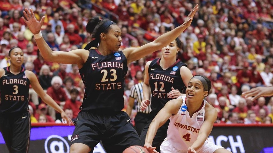 Iowa State's Nikki Moody (4) passes the ball past Florida State's Ivey Slaughter (23) with Florida State's Brittany Brown (12) and Emiah Bingley (3) looking on in the first half of a first-round game in the NCAA women's college basketball tournament in Ames, Iowa, Saturday, March 22, 2014. (AP Photo/Nati Harnik)