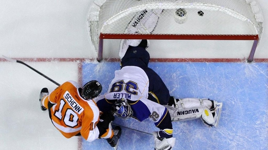 Philadelphia Flyers' Brayden Schenn, left, scores a goal against St. Louis Blues' Ryan Miller during the second period of an NHL hockey game, Saturday, March 22, 2014, in Philadelphia. (AP Photo/Matt Slocum)