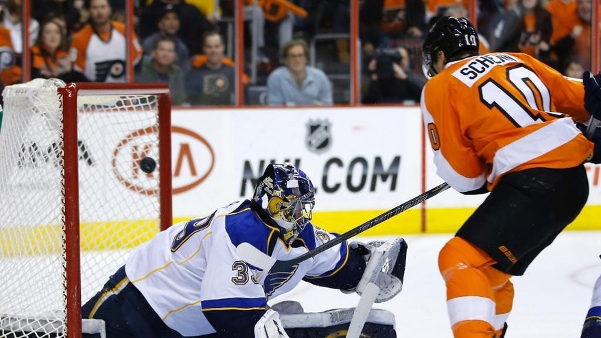 Philadelphia Flyers' Brayden Schenn, right, scores a goal against St. Louis Blues' Ryan Miller during the second period of an NHL hockey game, Saturday, March 22, 2014, in Philadelphia. (AP Photo/Matt Slocum)