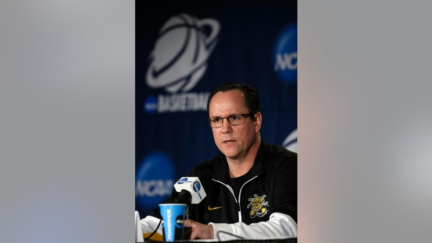 Wichita State head coach Gregg Marshall speaks during a news conference at the NCAA college basketball tournament Saturday, March 22, 2014, in St. Louis. Wichita State plays Kentucky in third-round game on Sunday. (AP Photo/Jeff Roberson)