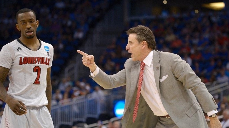 Louisville coach Rick Pitino, right, yells at guard Russ Smith (2) during the second half in a third-round game in the NCAA college basketball tournament against Saint Louis,  Saturday, March 22, 2014, in Orlando, Fla. (AP Photo/Phelan M. Ebenhack)