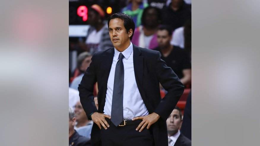 Miami Heat coach Erik Spoelstra watches during the first half of an NBA basketball game against the Memphis Grizzlies in Miami, Friday, March 21, 2014. (AP Photo/J Pat Carter)