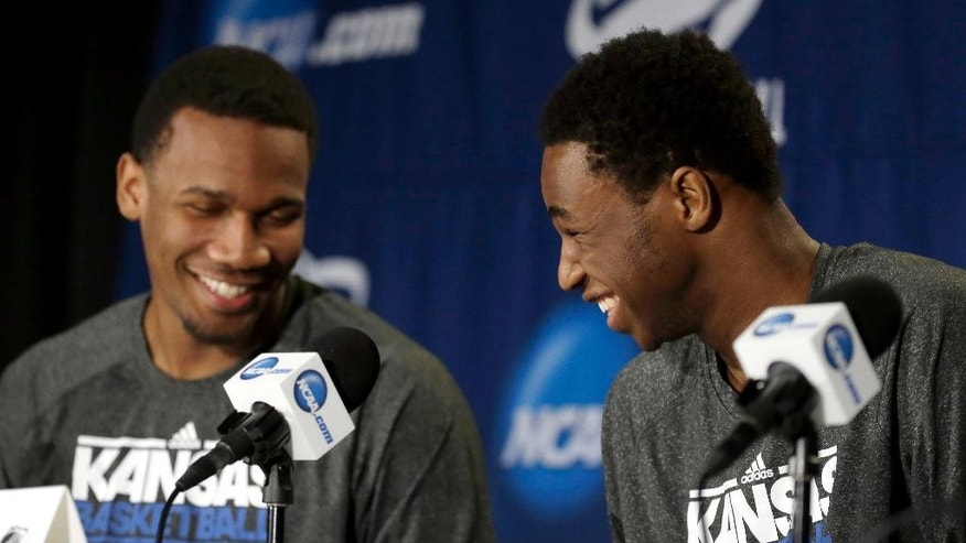 Kansas' Andrew Wiggins, right, and teammate Wayne Selden, Jr. laugh at question during a news conference for the third-round game of the NCAA college basketball tournament, Saturday, March 22, 2014, in St. Louis. Kansas is scheduled to play Stanford on Sunday. (AP Photo/Jeff Roberson)