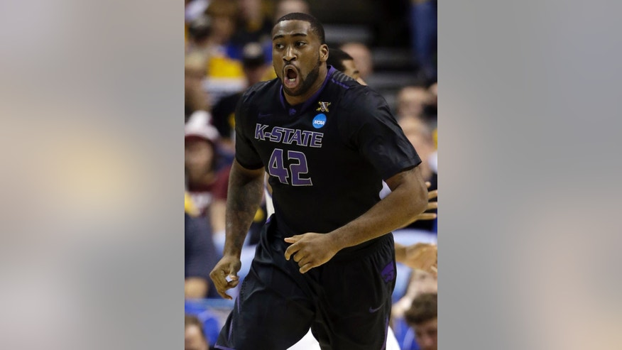 Kansas State's Thomas Gipson celebrates after making a basket during the first half of a second-round game against Kentucky in the NCAA college basketball tournament Friday, March 21, 2014, in St. Louis. (AP Photo/Jeff Roberson)