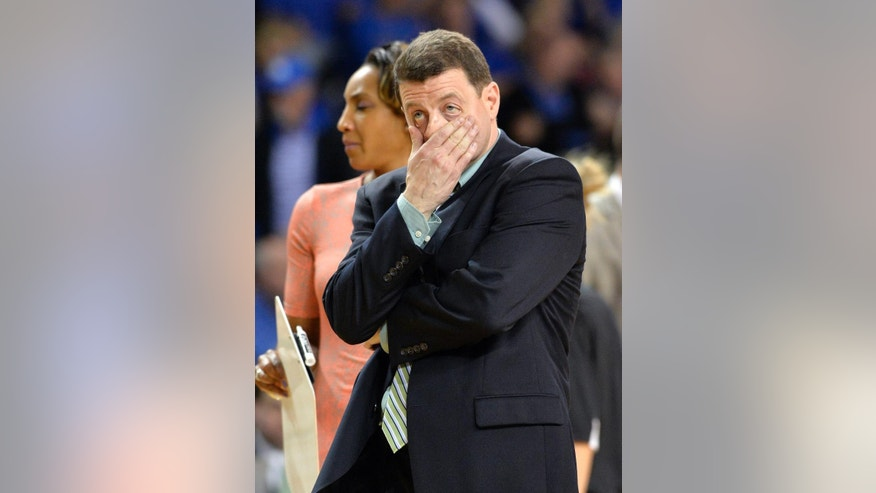 Wright State head coach reacts to his teams play against Kentucky during the first half of a first-round game in the NCAA women's college basketball tournament in Lexington, Ky., Saturday, March 22, 2014. (AP Photo/Timothy D. Easley)