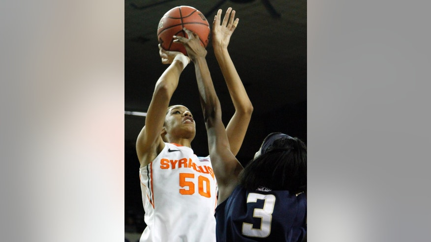 Syracuse's Briana Day (50) shoots over Chattanooga's Jasmine Joyner (3) during the first half of a first-round game in the NCAA women's college basketball tournament in Lexington, Ky., Saturday, March 22, 2014. (AP Photo/James Crisp)