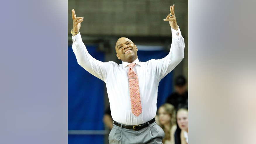 Syracuse head coach Quentin Hillsman reacts to a play during the first half of a first-round game against Chattanooga at the NCAA women's college basketball tournament in Lexington, Ky., Saturday, March 22, 2014. (AP Photo/James Crisp)
