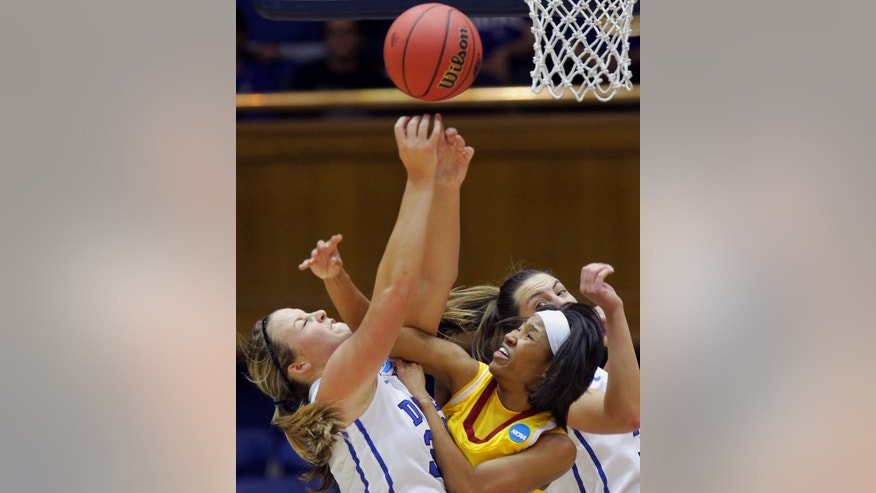 Duke's Tricia Liston, left, and Haley Peters, right, fight for a rebound with Winthrop's Samiya Wright during the first half of their first-round game in the NCAA basketball tournament in Durham, N.C., Saturday, March 22, 2014.  (AP Photo/Ted Richardson)