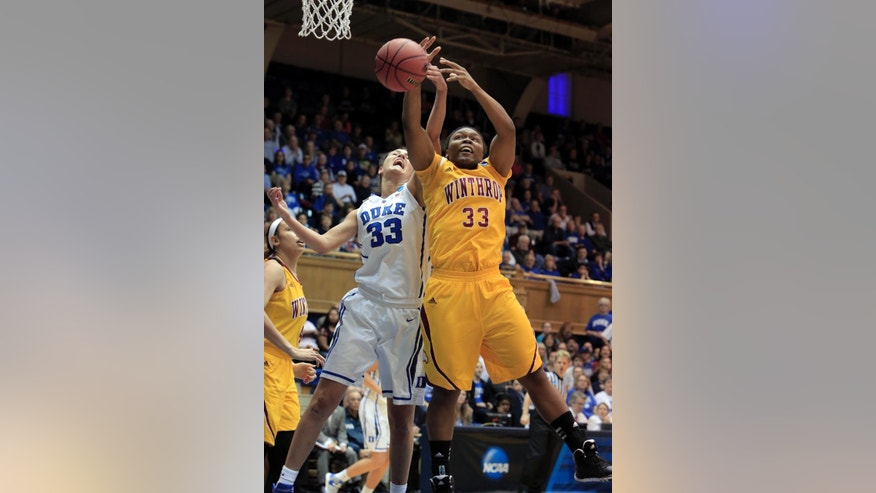 Duke's Haley Peters, left, fights for a rebound with Winthrop's Erica Williams during the first half of their first-round game in the NCAA basketball tournament in Durham, N.C., Saturday, March 22, 2014. (AP Photo/Ted Richardson)