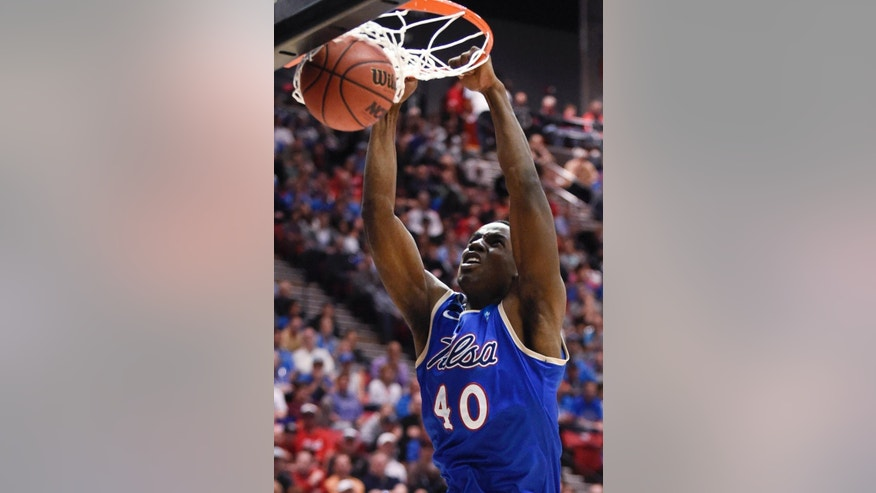 Tulsa forward D'Andre Wright dunks against UCLA during the first half of a second-round game in the NCAA men's college basketball tournament Friday, March 21, 2014, in San Diego. (AP Photo/Denis Poroy)