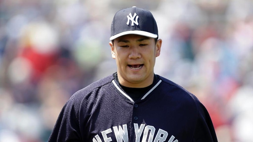 New York Yankees starting pitcher Masahiro Tanaka reacts as he walks off the mound at the end of the third innings of an exhibition baseball game against the Minnesota Twins in Fort Myers, Fla., Saturday, March 22, 2014. (AP Photo/Gerald Herbert)