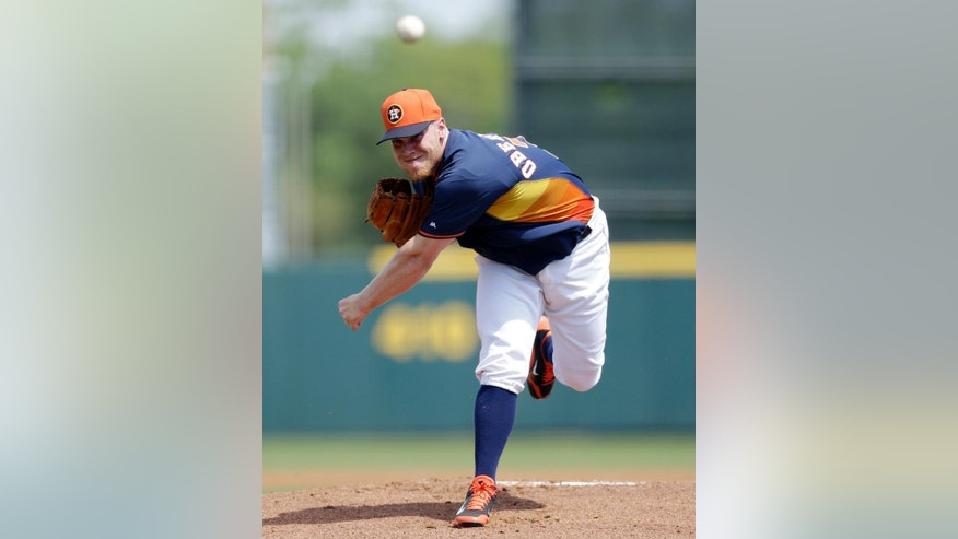 Houston Astros pitcher Brett Oberholtzer throws during the first inning of a spring exhibition baseball game against the St. Louis Cardinals in Kissimmee, Fla., Saturday, March 22, 2014. (AP Photo/Carlos Osorio)