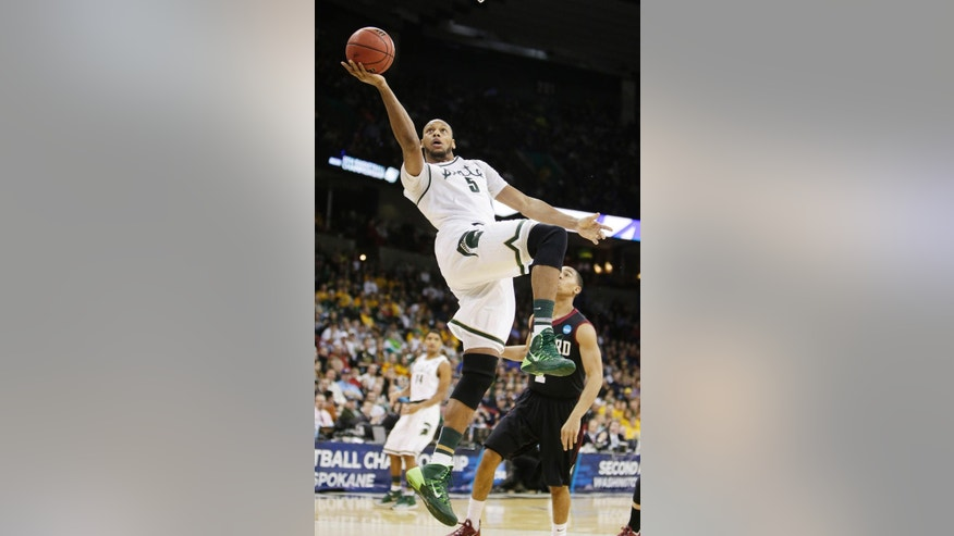 Michigan State's Adreian Payne (5) shoots a layup in the first half during the third-round game of the NCAA men's college basketball tournament against Harvard in Spokane, Wash., Saturday, March 22, 2014. (AP Photo/Young Kwak)