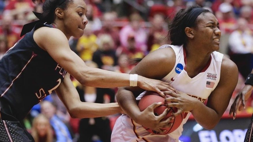 Florida State's Ivey Slaughter, left, and Iowa State's Fallon Ellis (32) struggle for the ball in the second half of a first-round game in the NCAA women's college basketball tournament in Ames, Iowa, Saturday, March 22, 2014. Florida State won 55-44. (AP Photo/Nati Harnik)