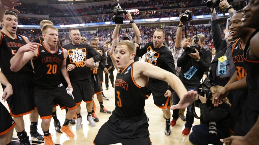 March 21, 2014: Mercer guard Kevin Canevari (3) dances with team mates after the second half of an NCAA college basketball second-round game against Duke, in Raleigh, N.C.