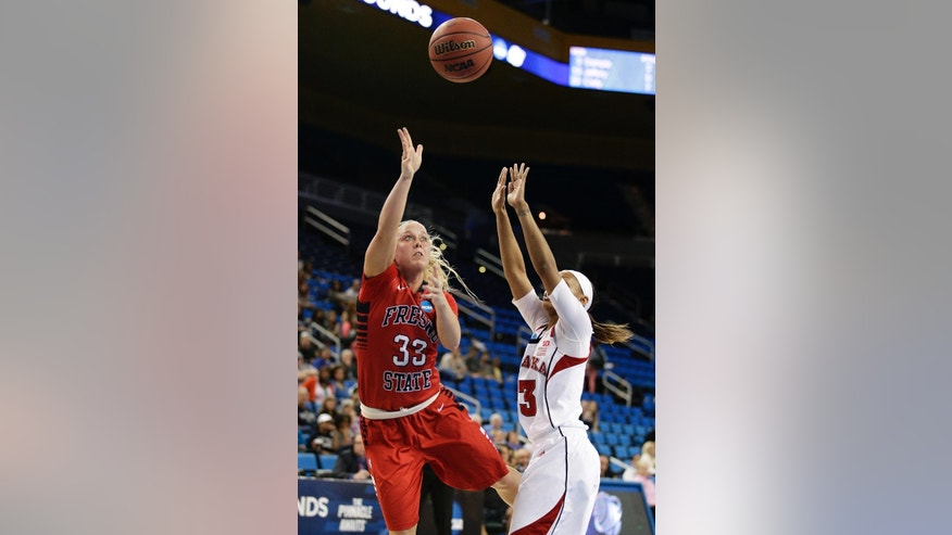 Fresno State's Taylor Thompson, left, puts up a shot against Nebraska's Hailie Sample during the first half of a first-round game in the NCAA women's college basketball tournament on Saturday, March 22, 2014, in Los Angeles. (AP Photo/Jae C. Hong)