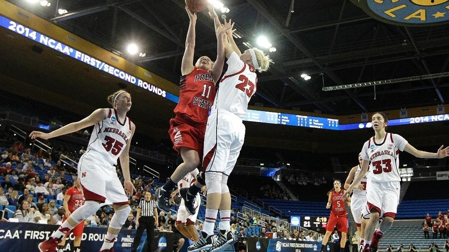 Fresno State's Alex Furr (11) goes up for a basket as she is defended by Nebraska's Emily Cady (23) during the first half of a first-round game in the NCAA women's college basketball tournament on Saturday, March 22, 2014, in Los Angeles. (AP Photo/Jae C. Hong)