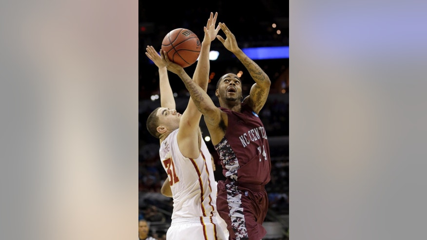 North Carolina Central's Jeremy Ingram (14) goes up for a shot as Iowa State Cyclones's Georges Niang (31) defends during the second half of a second-round game in the NCAA college basketball tournament Friday, March 21, 2014, in San Antonio. Iowa State won 93-75. (AP Photo/David J. Phillip)
